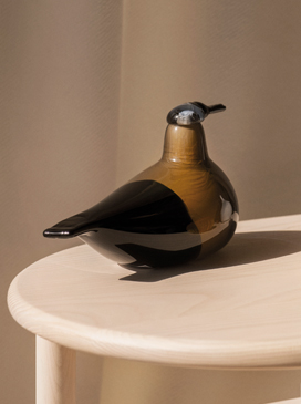Handcrafted and mouthblown at the Iittala Glass Factory, the Annual Bird 2020, Kaisla bird features a small blue head, prominent beak with a golden brown and black duck shape body
